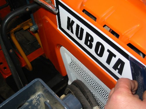 For applying the longer decals to your Kubota, pre-wet the area with Windex before applying. This will give you a chance to position the decal a bit better without having to worry about getting the exact right away. Press the excess out with a squeege and the job is done.