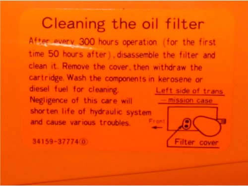 Close-up of the filter service decal Kubota affixed to early B and L series tractors equipped with screen filters.