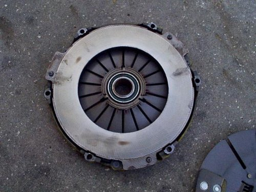 A flywheel with friction hot spots burned into its surface.