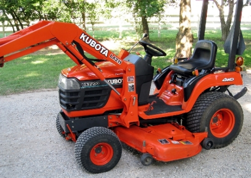 BX2200 with a LA211 front end loader and a mid-mount deck