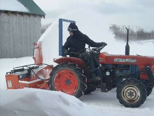 The farm's Kubota L2201 earns its keep - snowblowing, rototilling, hauling or running the irrigation system.