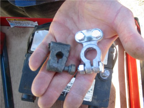 Comparison between old connectors that need replacement. The old connector had a crack all the way through its right side. This meant regardless of how tight the connector was closed around the post, a good connection would never be made.