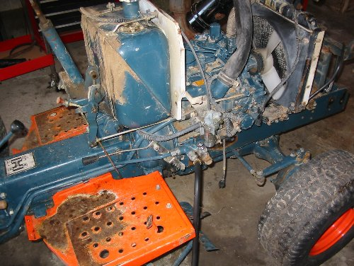 A Kubota B6200 with sheet metal removed before a much needed wash and engine degrease