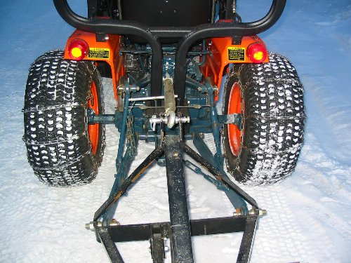 Tire chains installed on the turf tires of this B6200 boost traction enough for us to use a snow blade to clear the driveway.