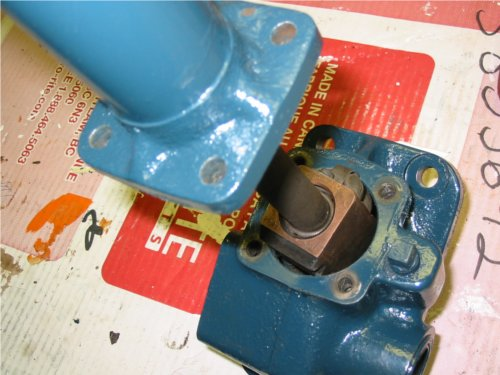 Removing the 4 bolts at the base of the steering column exposes the steering shaft ball nut assembly within the steering box.