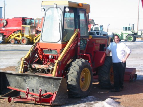 Service Department Vic standing beside a Versatile 160 bidirectional tractor. Versatile built the 160 from 1982-1983.